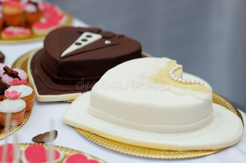 Bride and groom cakes stock photos