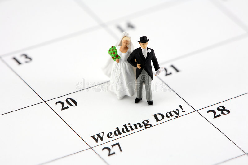 Bride and groom on calendar stock photography