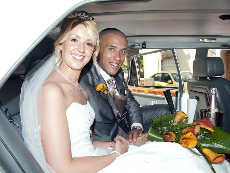 Bride and Groom in a car royalty free stock images