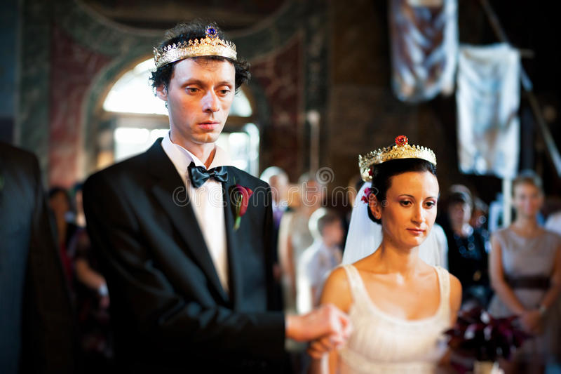 Bride and groom in church at wedding stock images