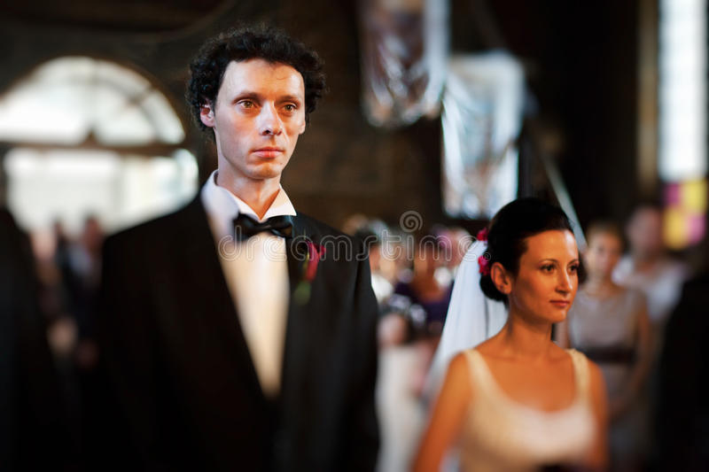 Bride and groom in church royalty free stock image
