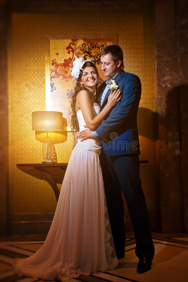Bride and groom in the classic style living room royalty free stock photography