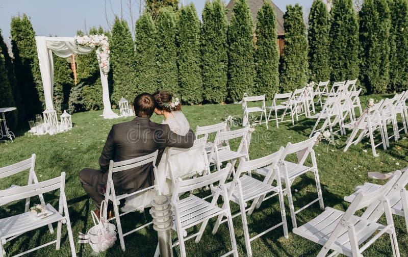 Bride groom close together holding hands hugging stock photo