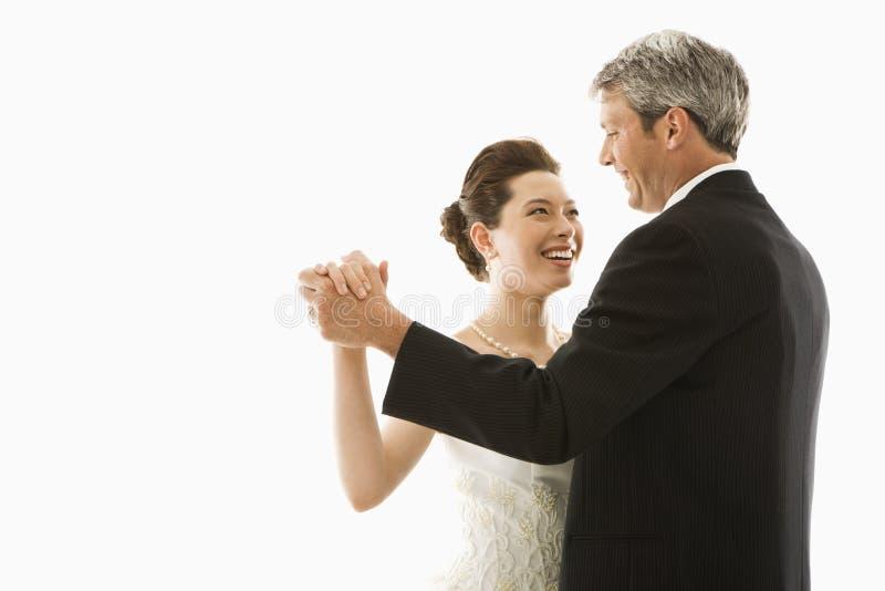 Bride and groom dancing. stock photos