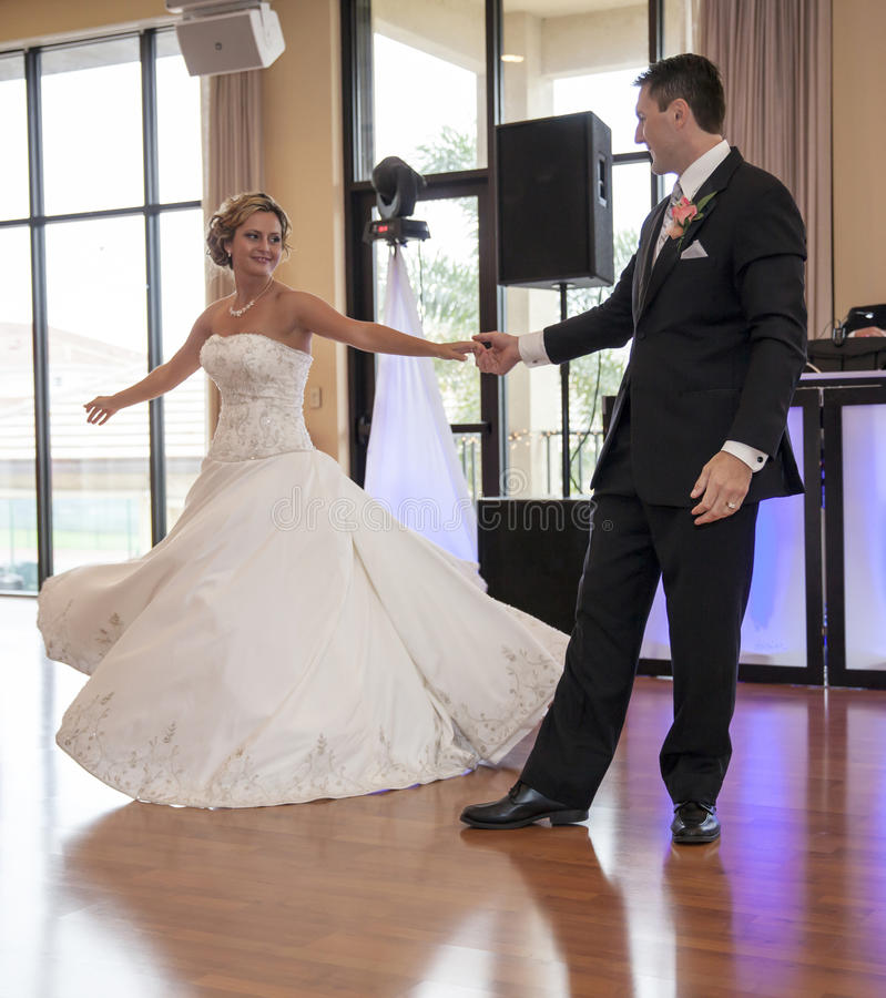 Bride and Groom dancing. A happy bride and groom dancing during reception royalty free stock images