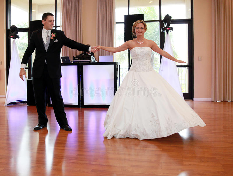Bride and Groom dancing royalty free stock image