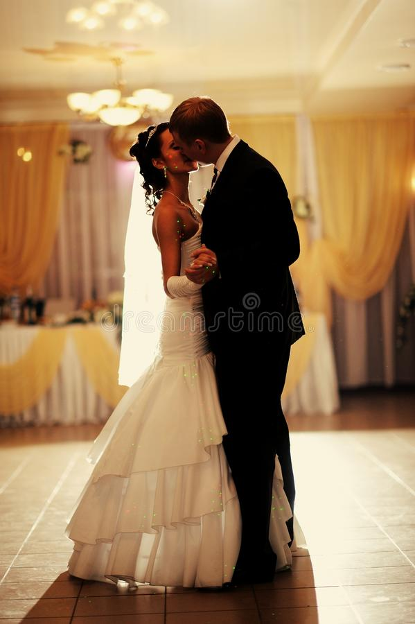 Bride and groom dancing royalty free stock photography
