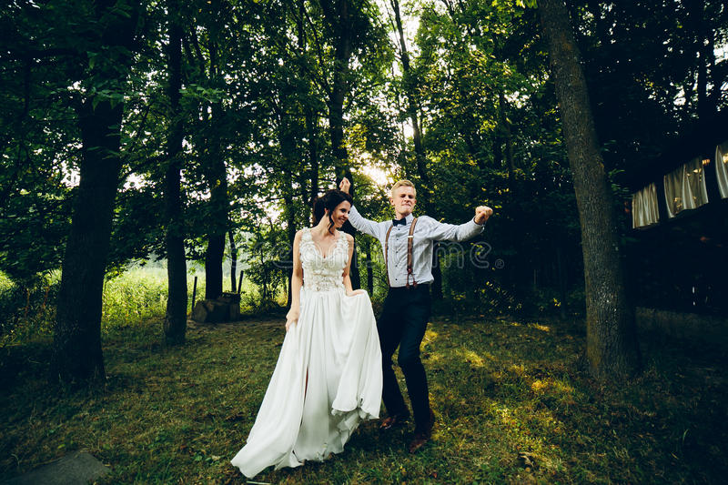 Bride and groom dancing in nature stock images