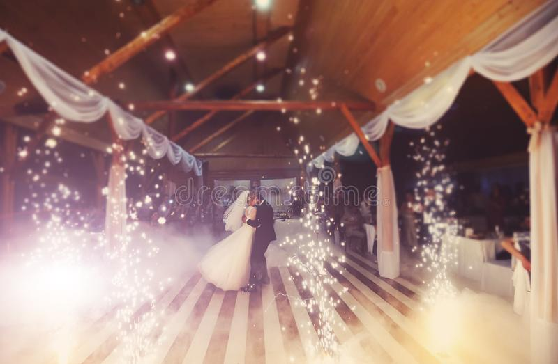 bride and groom dancing on the own wedding stock images