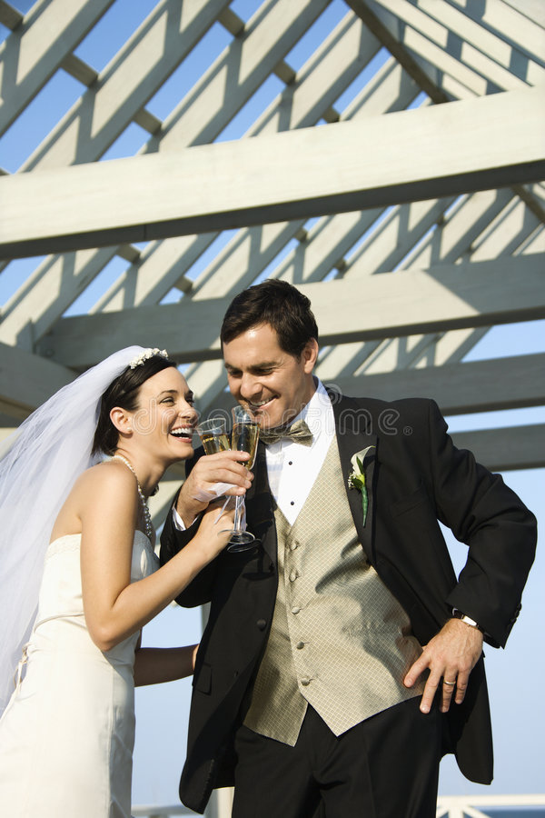 Bride and groom drinking stock images