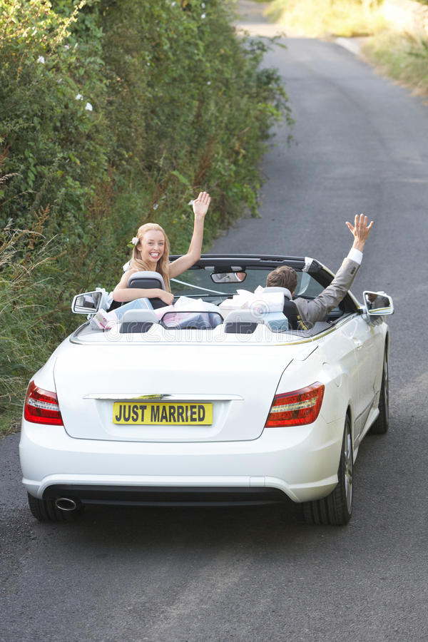 bride and groom driving away in decorated car stock image image of