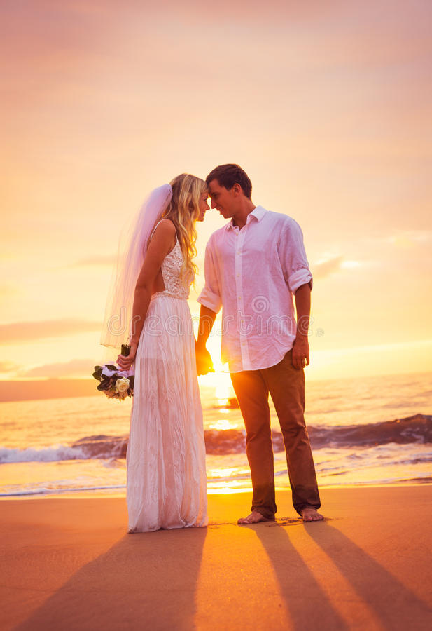 Download Bride And Groom, Enjoying Amazing Sunset On A Beautiful Tropical Royalty Free Stock Photography - Image: 36073917