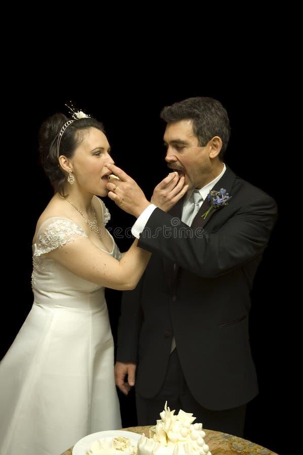Bride and Groom feeding eachother cake