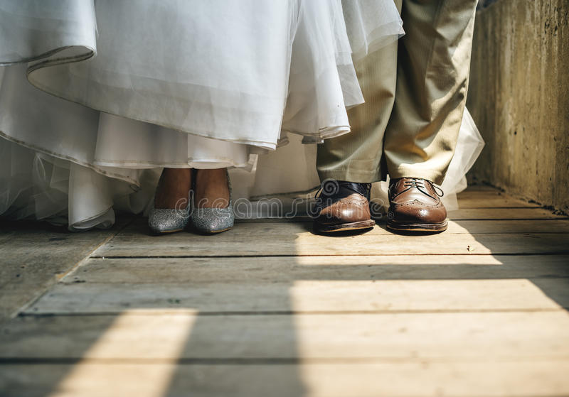 Bride and Groom Feet Standing on Wooden Floor royalty free stock images