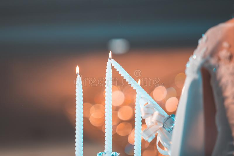 Bride and groom are fire at candle in wedding ceremony party at night. Wedding royalty free stock images