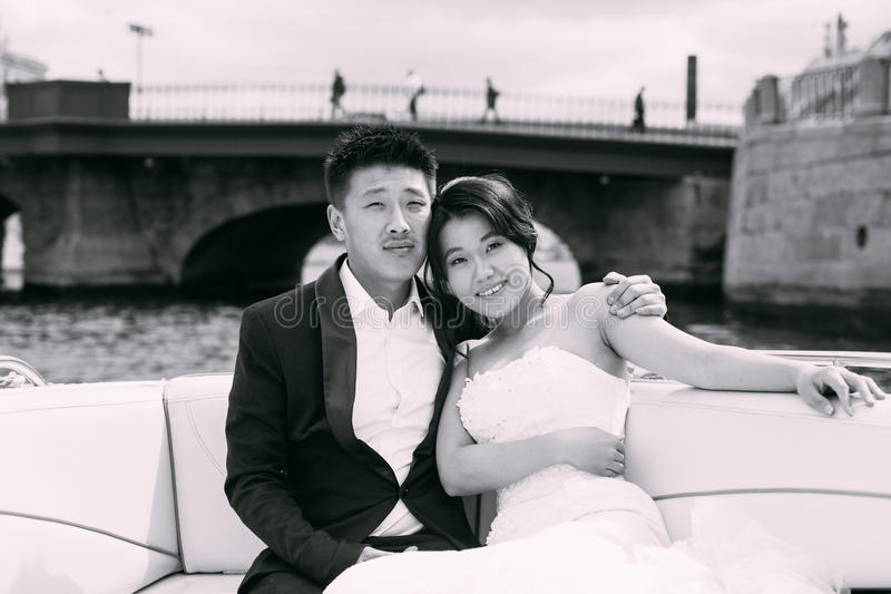 Bride and groom are floating on a boat. On the city`s rivers and canals royalty free stock photo
