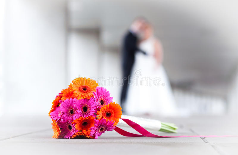 bride and groom with flowers royalty free stock photos