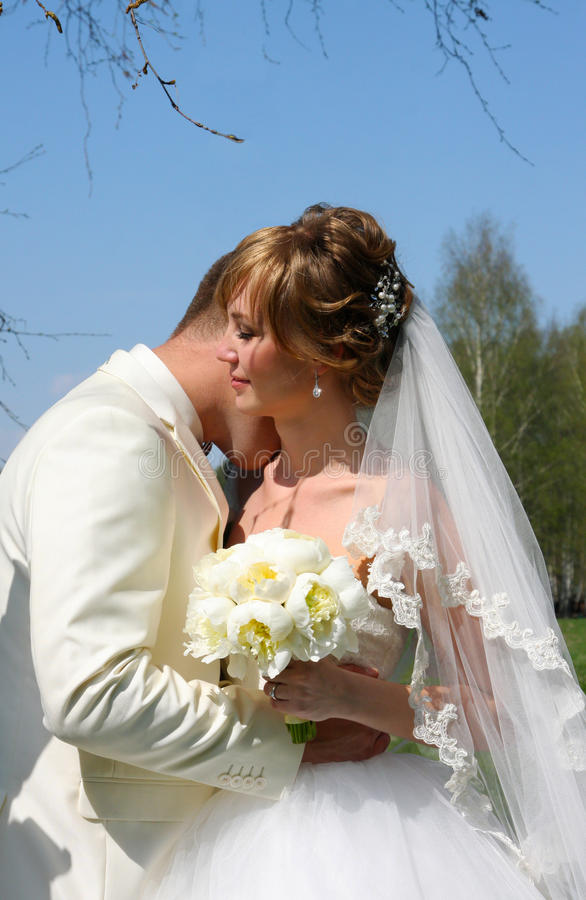 Bride and groom with flowers stock images