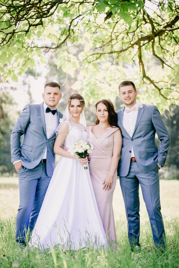 Bride and groom with friends on the holiday royalty free stock photo