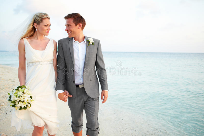Download Bride And Groom Getting Married In Beach Ceremony Stock Photo - Image: 31697518