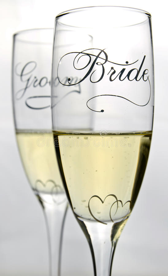 Bride and groom glasses royalty free stock images