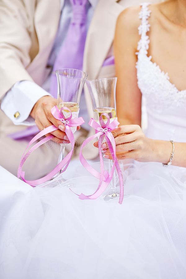 Bride and groom with glasses of champagne wine stock photo