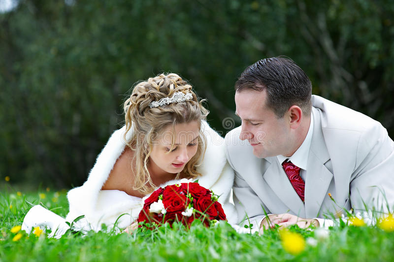 Bride and groom are on the grass