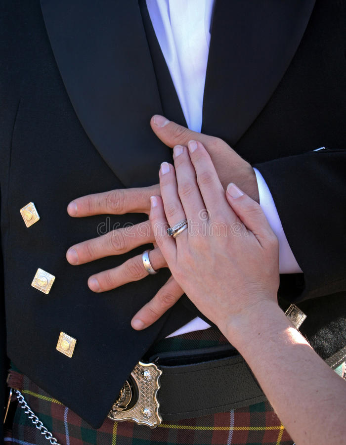 Download Bride And Groom Hands Resting On Groom Stomach Stock Image - Image: 17042075
