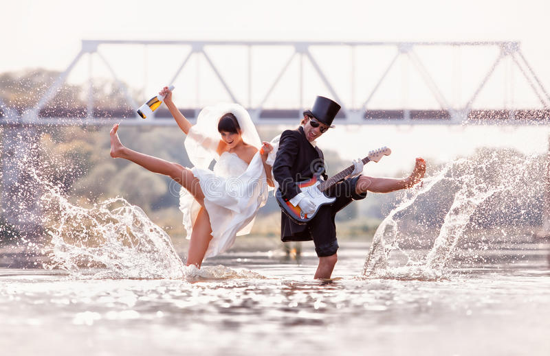 Bride and groom is happy in the river stock photos