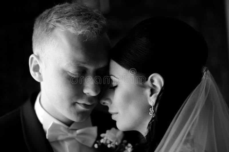 Bride and groom having a romantic moment stock photos