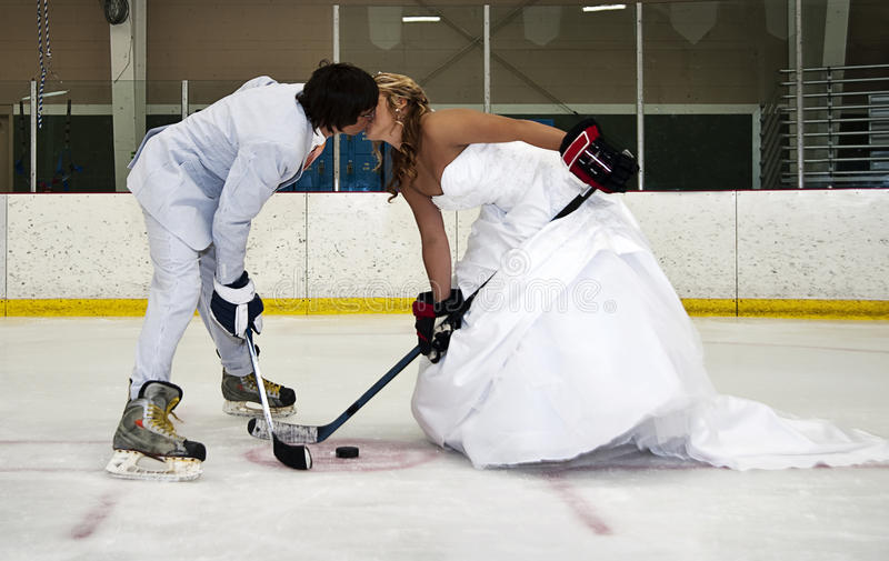 Download Bride And Groom Hockey Face Off Stock Image - Image: 21123985