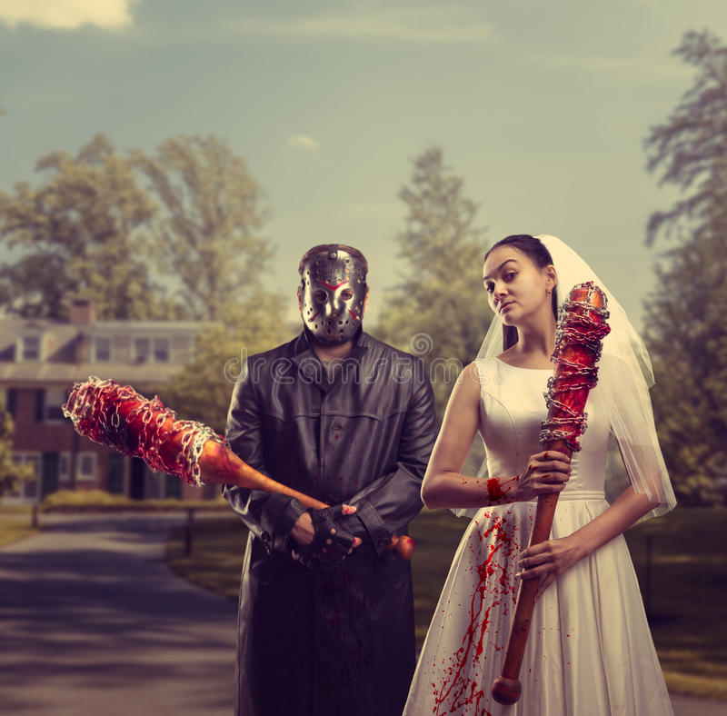 Bride and groom in hockey mask, maniac family stock images