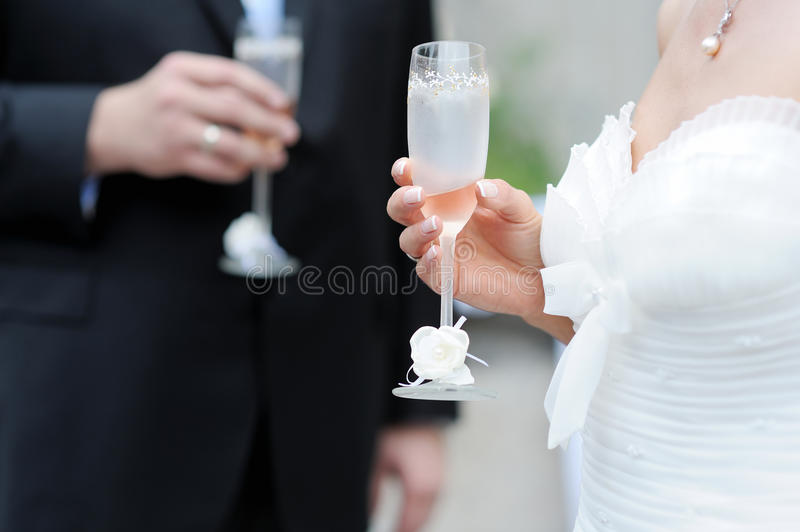 Download Bride And Groom Holding Champagne Glasses Stock Photo - Image: 17125420