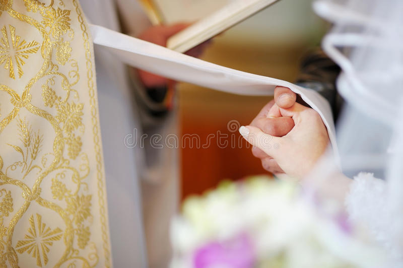 Bride and groom are holding each other's hands stock images