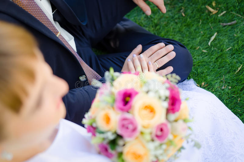 Bride and groom holding each others hands stock images