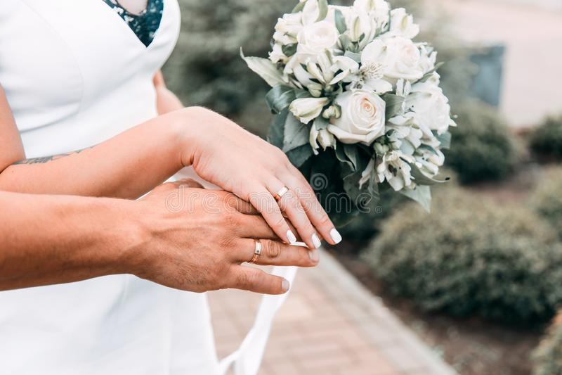 Bride and Groom holding hands during wedding day royalty free stock image