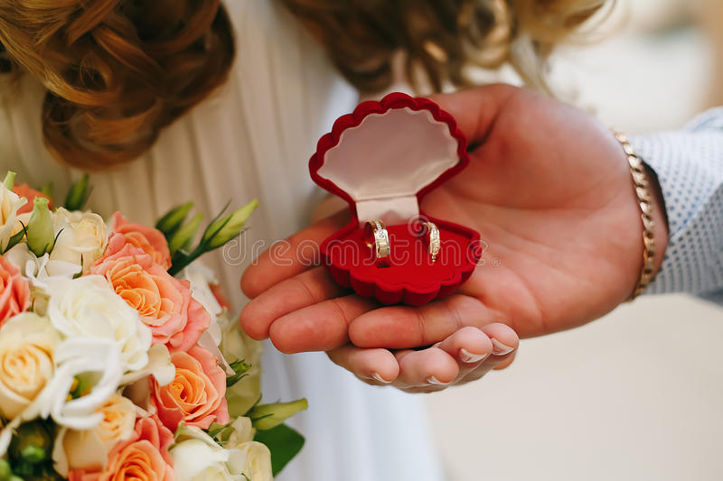 Bride and groom holding ring box stock photography