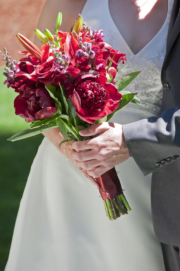 Bride And Groom Holding Rose Stock Photo