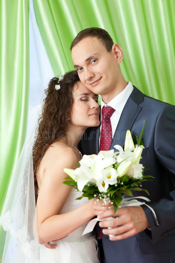 Bride and groom at home stock photo