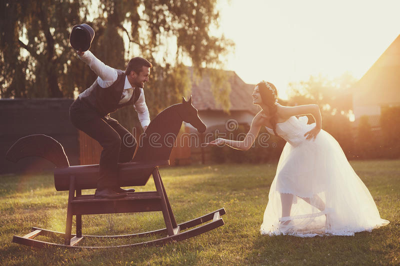 Bride and groom with a horse stock photo