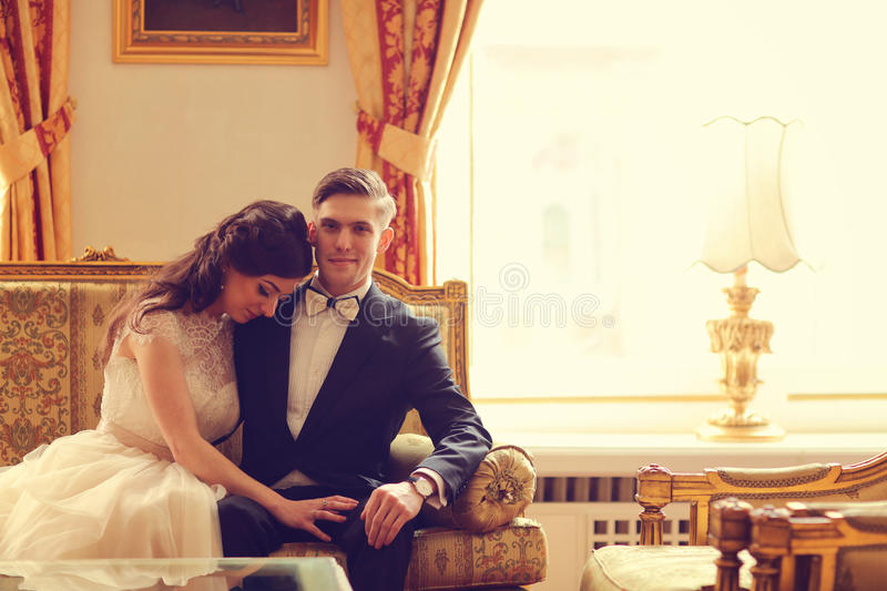 Bride and groom in a hotel room royalty free stock photo