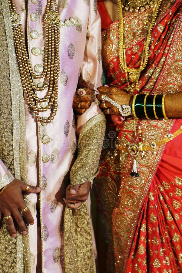 Bride and groom in Indian traditional attire royalty free stock photo