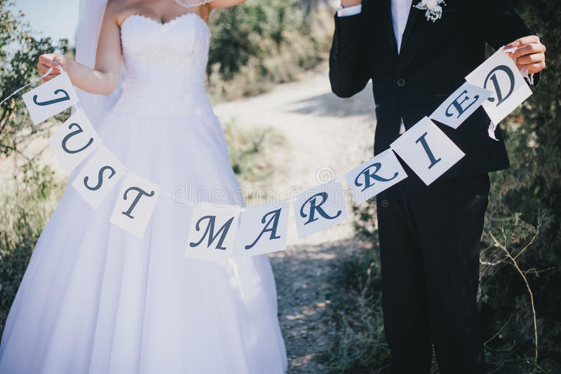 Bride and groom with Just married sign royalty free stock photography
