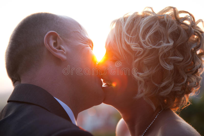 Download Bride And Groom Kissing At Sunset Royalty Free Stock Photo - Image: 21961295