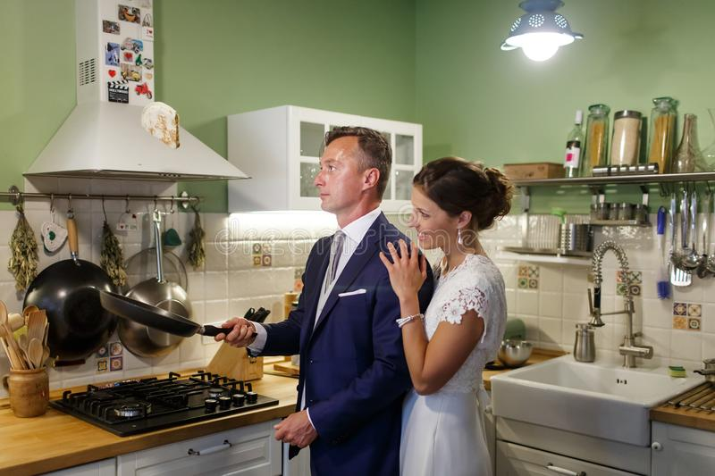 Bride and groom in the kitchen stock photos