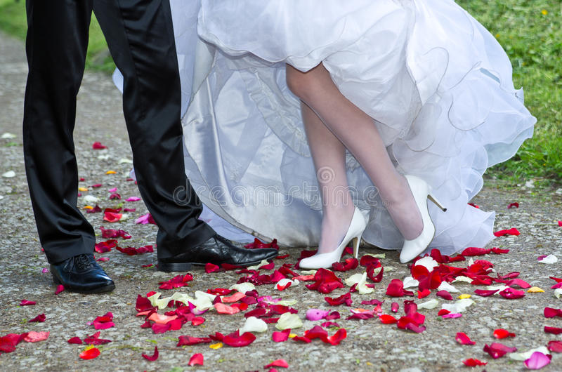 Bride and groom legs royalty free stock photos