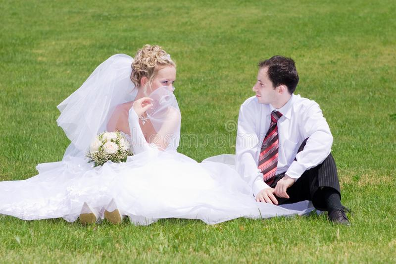 A bride and a groom looking one to another on the stock photo