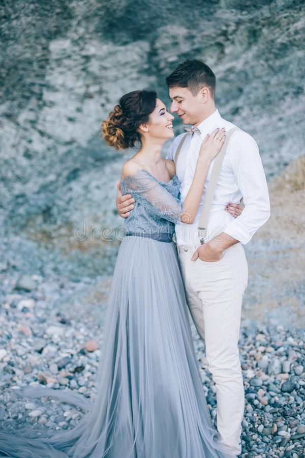 The bride and groom in nature in summer. Wedding. Of a beautiful women in a long dress with a brunette man stock images