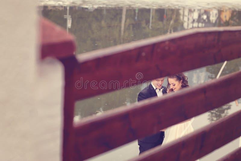 Bride and groom near lake stock photos