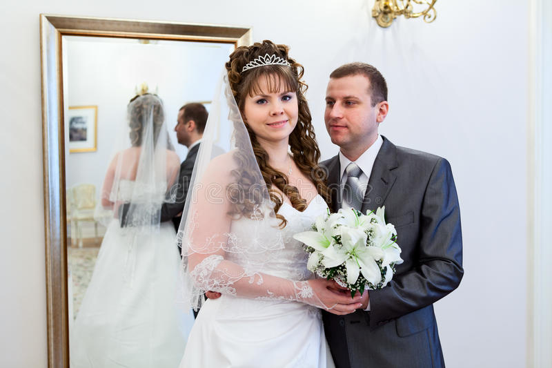 Download Bride And Groom Near Mirror Stock Photo - Image of male, cute: 25619720